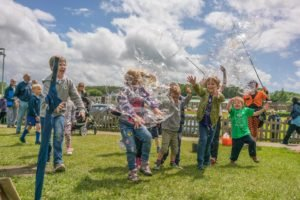 children chasing bubbles